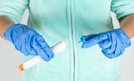Prepare epinephrine injector to use