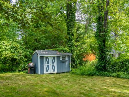 Stock foto van de schuur in de privé achtertuin