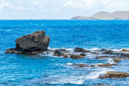 Ocean surf on the tropical rocky beach
