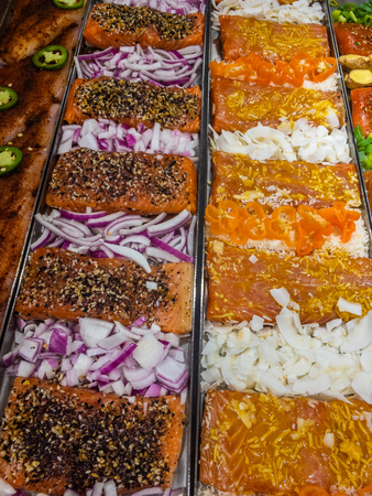 Marinated salmon on display at the store Imagens