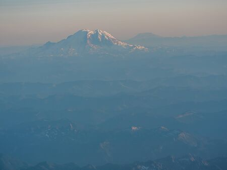 View on Mount Rainier from airplane window during a flight