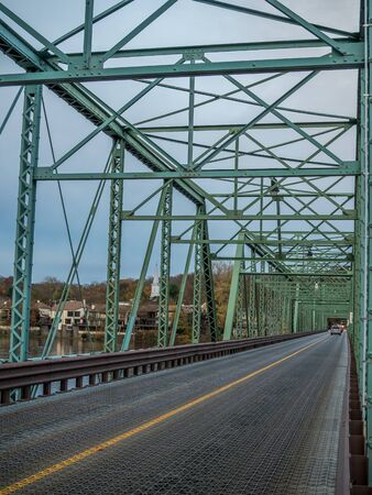 Old metal frame bridge over Delaware River connecting New Jersey and Pennsylvania states