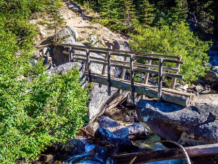 Bridge over the stream on the trail at Alpine Wilderness in North Cascade Mountains in Washington State