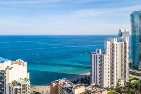 Aerail view of Atlantic Ocean thorugh the towers of waterfront in South Florida Фото со стока