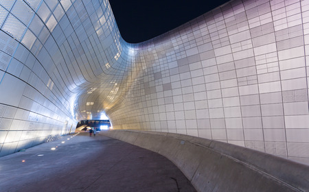 new development: SEOUL, SOUTH KOREA - MARCH 29,2015: Dongdaemun Design Plaza at Night, New development in Seoul, designed by Zaha Hadid. Photo taken March 29, 2015 in Seoul, South Korea. Editorial