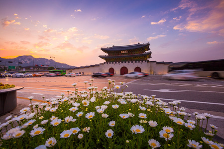 Gyeongbokgung Palace, Cars passing in front of Gwanghuamun gate after sunset in downtown Seoul, South Korea. Name of the gate gated light
