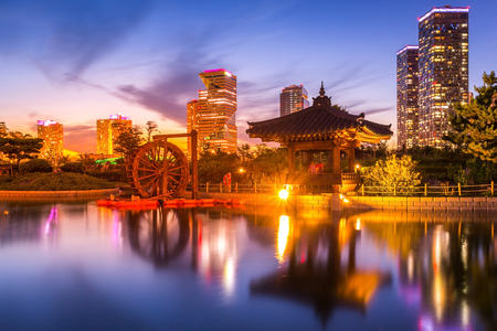 traditional and modern architecture of seoul city after sunset, central park in songdo International business district, Incheon South Korea. Stock Photo