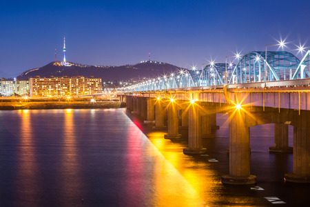 turnpike: Seoul city and bridge and Han river,n seoul tower at night,  South Korea. Stock Photo