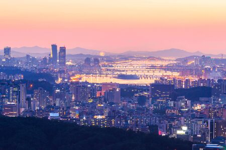 Seoul city skyline and skyscraper in and han river, South Korea.