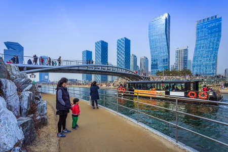 Incheon, South Korea - March 08, 2015: People are riding a tourist boat in summer of Korea at Central Park in Songdo District, Incheon South Korea. Редакционное