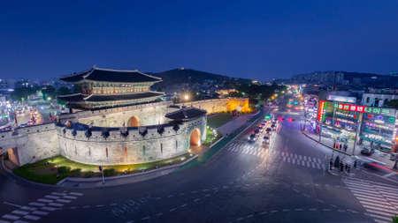 Suwon, South Korea - November 12, 2019:  Janganmun gate And traffic in night at Hwaseong Fortress, Suwon, South Korea.