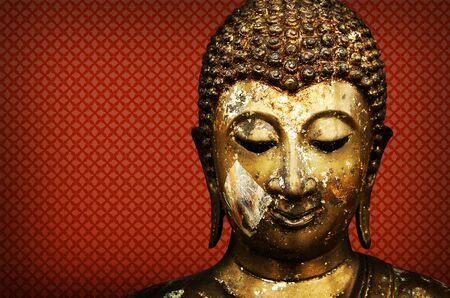Buddha Face red Background  photo
