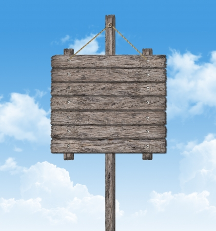 Old weathered wood sign on sky  photo