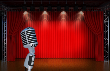 varieties: vintage microphone on Theater stage with red curtains and spotlights  Theatr ical scene in the light of searchlights, the interior of the old theater   Stock Photo