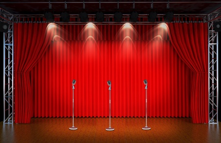 searchlights: vintage microphone on Theater stage with red curtains and spotlights  Theatr ical scene in the light of searchlights, the interior of the old theater   Stock Photo