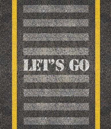 Warning concept   paint on asphalt road  photo