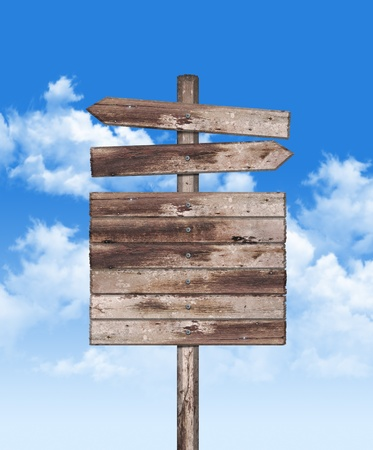 direction board: Old weathered wood on blue sky