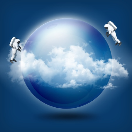 A glass transparent ball with astronaut on blue sky  Stock Photo