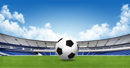 Sports background - soccer ball on green stadium  photo