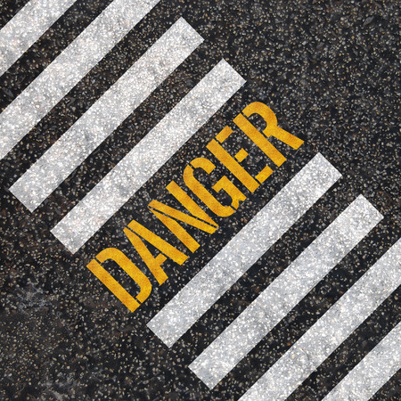 Danger concept   paint on asphalt road  photo