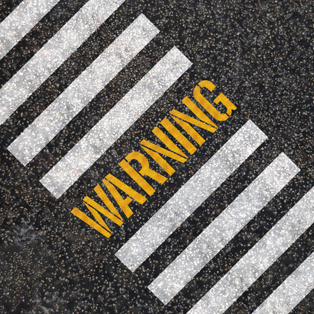 Warning concept   paint on asphalt road  Stock Photo - 24969542