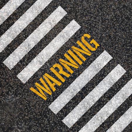 Warning concept   paint on asphalt road Stock Photo - 24969542