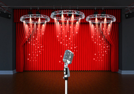 vintage microphone on Theater stage with red curtains and spotlights Theatrical scene in the light of searchlights, the interior of the old theater  Stock Photo