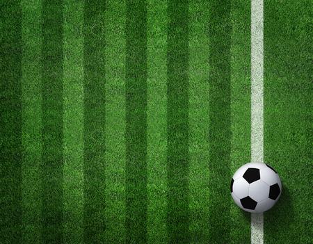 green grass: soccer football on grass field