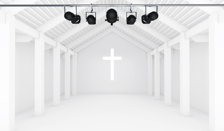 heavenly light: An interior building with window in the shape of a crucifix with a spotlight shining lights rays through it