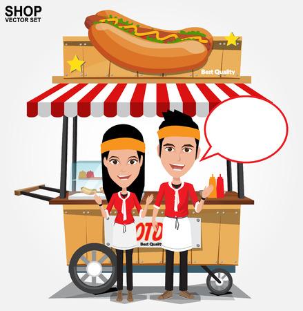 hot dog: hot dog street cart with seller.