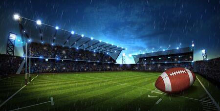 American Football on light of american football stadium Stock Photo