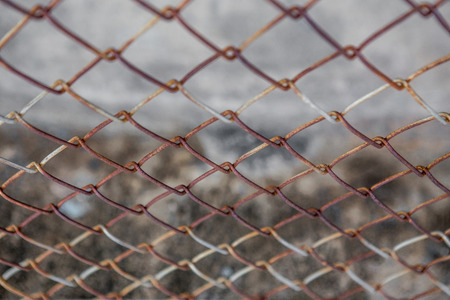 Selective focus of Fence grilles rust texture background
