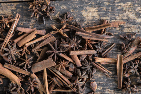 Star anise and Cinnamon on old wooden boards