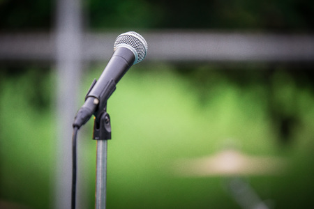 Microphone and Tripod on the blurred background Stock Photo