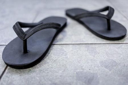 Black sandals on the floor background 版權商用圖片