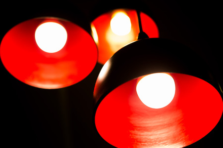 Red lamp on black background