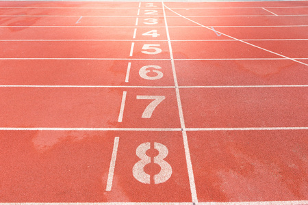 number on red Track in the stadium background Stock Photo