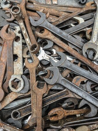 Many wrenches are rust on panels in antique shops