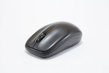 Black wireless mouse on white background