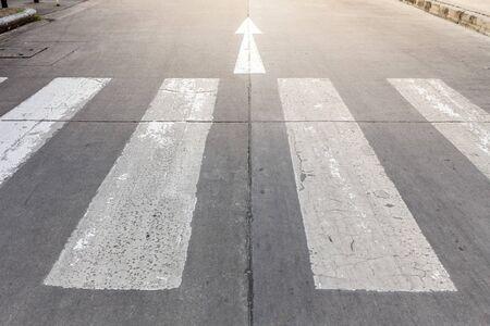 Arrow symbol and crosswalk on the street background