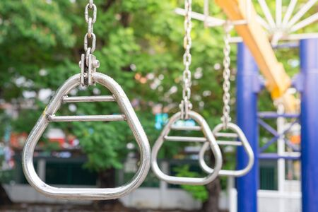 Steel hoop for climbing in the playground with sunlight