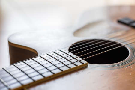 Selective focus of Scratches on the old acoustic guitar