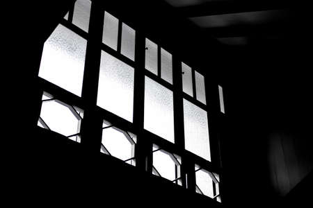 Silhouette of light from ancient windows