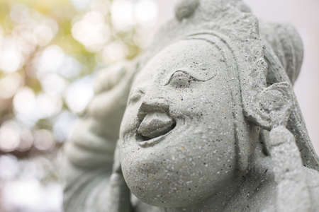 Ancient Chinese stone carvings on bokeh background