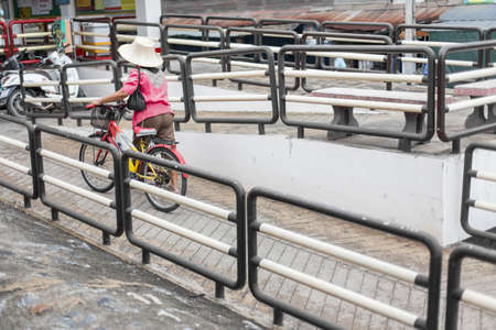 People are dragging a bicycle up the Ramp for the disabled