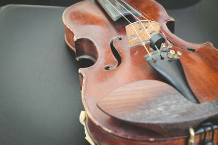 Selective focus of Violin on musician chair Stock Photo