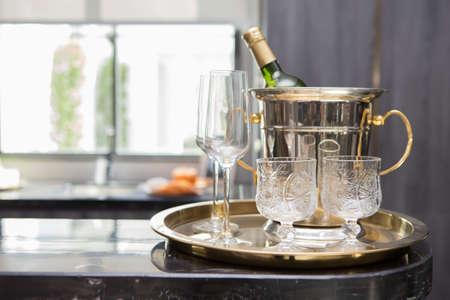 Wine Bottle and Glass in Brass Tray on counter bar Reklamní fotografie