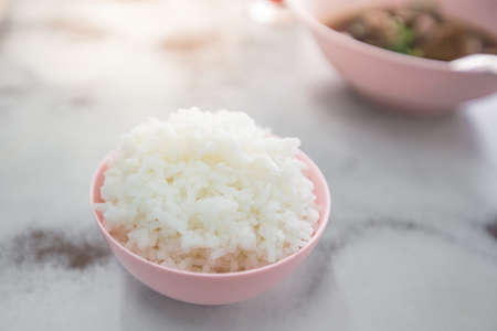Steamed rice in a cup Asian Culture on the table