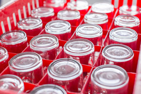 Selective focus of Drinking glass in red plastic crates