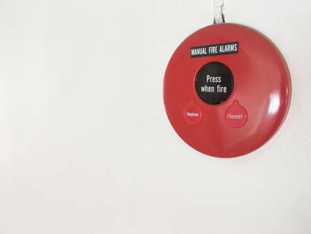 Fire Alarm Signal on white wall and copy space